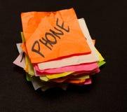 Opciones de la vida - gastar dinero en un teléfono Foto de archivo