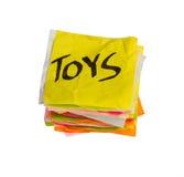 Opciones de la vida - tomando decisiones de gasto - juguetes Imagen de archivo libre de regalías