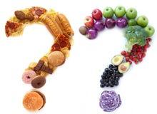 Opciones malsanas sanas de la comida Foto de archivo libre de regalías