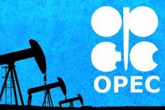OPEC logo i sylwetki nafcianej pompy przemysłowa dźwigarka obrazy royalty free
