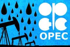 OPEC logo, olej krople i sylwetki nafcianej pompy przemysłowa dźwigarka, zdjęcie royalty free