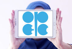 OPEC organization logo. Logo of OPEC organization on samsung tablet holded by arab muslim woman. Organization of the Petroleum Exporting Countries is an Stock Image