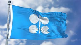 OPEC Waving Flag. Organization of the Petroleum Exporting Countries OPEC flag waving against clear blue sky, close up,  with clipping path mask luma channel Royalty Free Stock Image