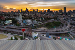Opeing wooden floor of Bangkok skyline with highway overpass intersection Royalty Free Stock Image