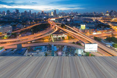 Opeing wooden floor of City skyline with highway overpass Royalty Free Stock Photos