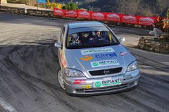 A Opel Astra GSI race car involved in the race. During the fifth edition of the `Ronde Della Val Merula` that took place in Italy, in the hinterland of Albenga Royalty Free Stock Photos
