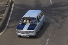 Opel Kadett blue driving on street view from top stock photo
