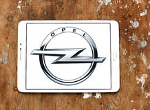 Opel logo. Logo of opel car brand on samsung tablet on wooden background Stock Photos