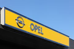 Opel logo on a wall. Odder, Denmark - November 26, 2015: Opel is a german automobile manufacturer headquartered in Russelsheim, Germany and a subsidiary of Royalty Free Stock Photos