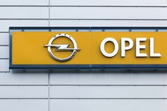 Opel logo on a wall. Risskov, Denmark - September 10, 2015: Opel logo on a wall. Opel is a german automobile manufacturer headquartered in Russelsheim, Germany Royalty Free Stock Images
