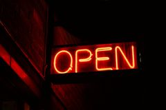 Open. Red open neon sign glowing in the night Royalty Free Stock Image