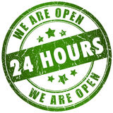 Open 24 hours. Green stamp over white Stock Photo
