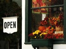 Open. Sign and fall decorated window at a country store stock image