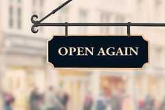 Free Open Again Sign Board Against Open Shop Windows Background. Restarting Business After Coronavirus Quarantine Lockdown Royalty Free Stock Images - 183293789