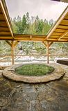 Open air bath outdoors in winter. Iron tub for bathing in hot water.  royalty free stock images