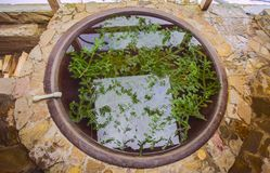 Open air bath outdoors in winter. Iron tub for bathing in hot water.  royalty free stock photo