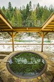 Open air bath outdoors in winter. Iron tub for bathing in hot water.  royalty free stock photography