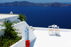 Open air cafe with beautiful view in Santorini Royalty Free Stock Images