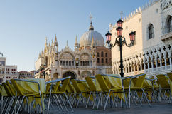 Open air cafe in Venice, Italy. Empty chairs aligned in early morning at the San Marko Square in Venice Italy Royalty Free Stock Photography