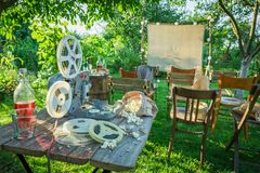 Open-air cinema with old analog films in the garden. Session in outside stock photos