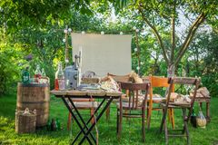 Open-air cinema with retro projector in the evening. In summer Royalty Free Stock Photography