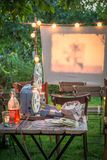 Open-air cinema with retro projector in the garden. In summer Royalty Free Stock Photography
