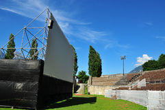 Open air Cinema in Roman Amphitheatre. Open air cinema placed in the centre of an ancient roman amphitheatre during the summer months. The location is Martigny Stock Images