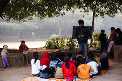 Open air classroom at hauz khas. Delhi, India: 4th Jan 2014 - Poor children being taught in an open air classroom by volunteers. Classes like this (madrasa) are Royalty Free Stock Images