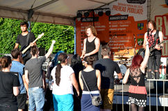 Open air concert of rock music band called The Paranoid. Concert is a part of summer of culture in the town. Stock Photos