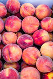 Open Air Farmers Market. Box full of fresh locally grown peaches for sale at local farmers market royalty free stock photos