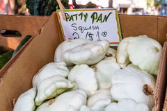 Open Air Farmers Market. Fresh local patty pan squash sitting in brown box for sale at local farmers market stock images