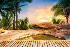 Open air hot spring spa. On natural background in sunset time royalty free stock photo