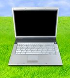 Open Air Laptop. Laptop Computer On Green Grass Royalty Free Stock Photo