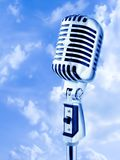 Open Air Mike. Vintage Microphone Over Blue Sky Royalty Free Stock Images