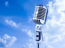 Open Air Mike. Retro Microphone Over Blue Sky Royalty Free Stock Photos