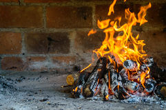 Open air oven fireplace with fire burning Royalty Free Stock Photo