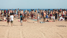 Open air party on sand beach. Barcelona Royalty Free Stock Image