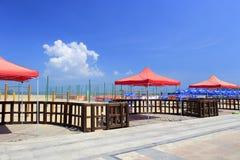 Open-air restaurant on coast sandy beach Royalty Free Stock Image