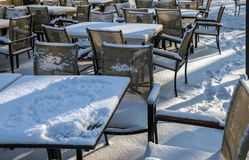 Open-air restaurant covered with snow royalty free stock photos