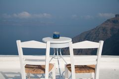 Open air restaurant with sea and mountain view Royalty Free Stock Photos
