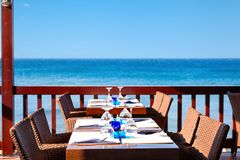 The open air restaurant by the sea is ready to receive visitors. Royalty Free Stock Photography