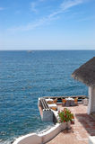 Open-air restaurant with a view on Atlantic Ocean Royalty Free Stock Photos