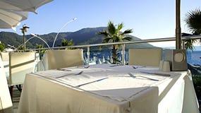 Table setting restaurant beach Royalty Free Stock Photography