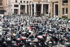 Open air scooter and motorbike parking in Genoa, Italy Royalty Free Stock Image