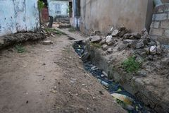 Open air sewer along a street at the Cupelon de Baixo neighborhood in the city of Bissau, Guinea Bissau. Guinea Bissau is one of the poorest countries in the royalty free stock image