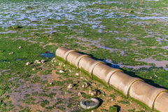 Open air sewer pipe draining to the Seixal Bay Stock Photos