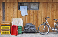 Open air storage, plastic bags, cargo boxes and bike Stock Photos