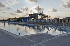 Open air swimming pool and aquapark at sunset in Cyprus. Royalty Free Stock Photos