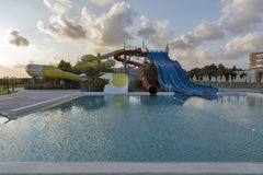Open air swimming pool and aquapark at sunset in Cyprus. Royalty Free Stock Photography