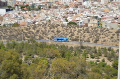 An Open Air tour Bus Coach In Spain - Mountain Village royalty free stock photo
